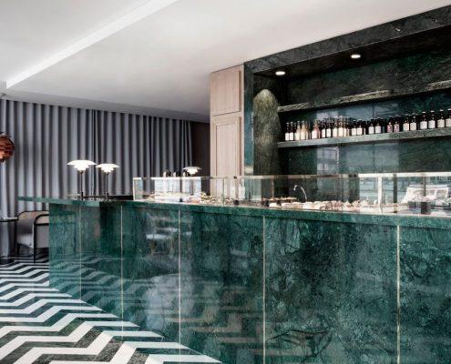 Photo of Maison du Danemark House of Denmark in Paris. Green stone bar top reflecting marble trends.